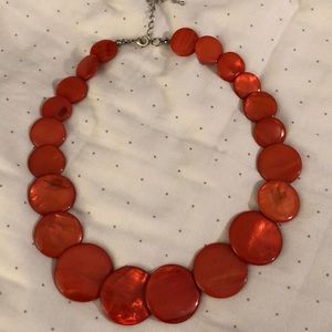 Francesca's orange disc necklace.